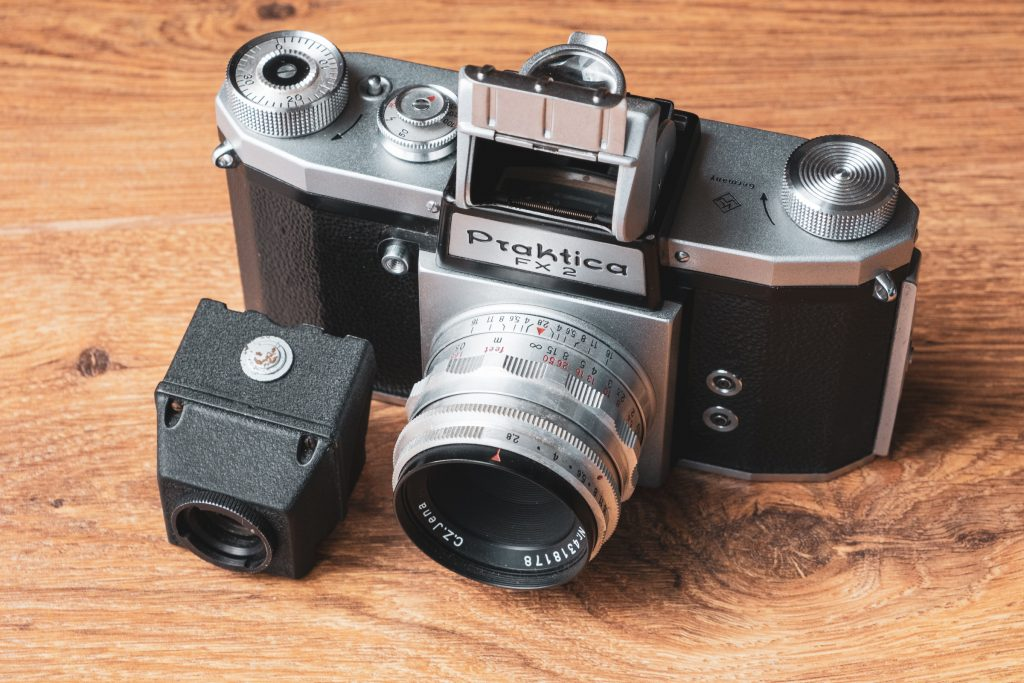 Praktica FX 2 with open viewfinder hood and slide up rear sight in place