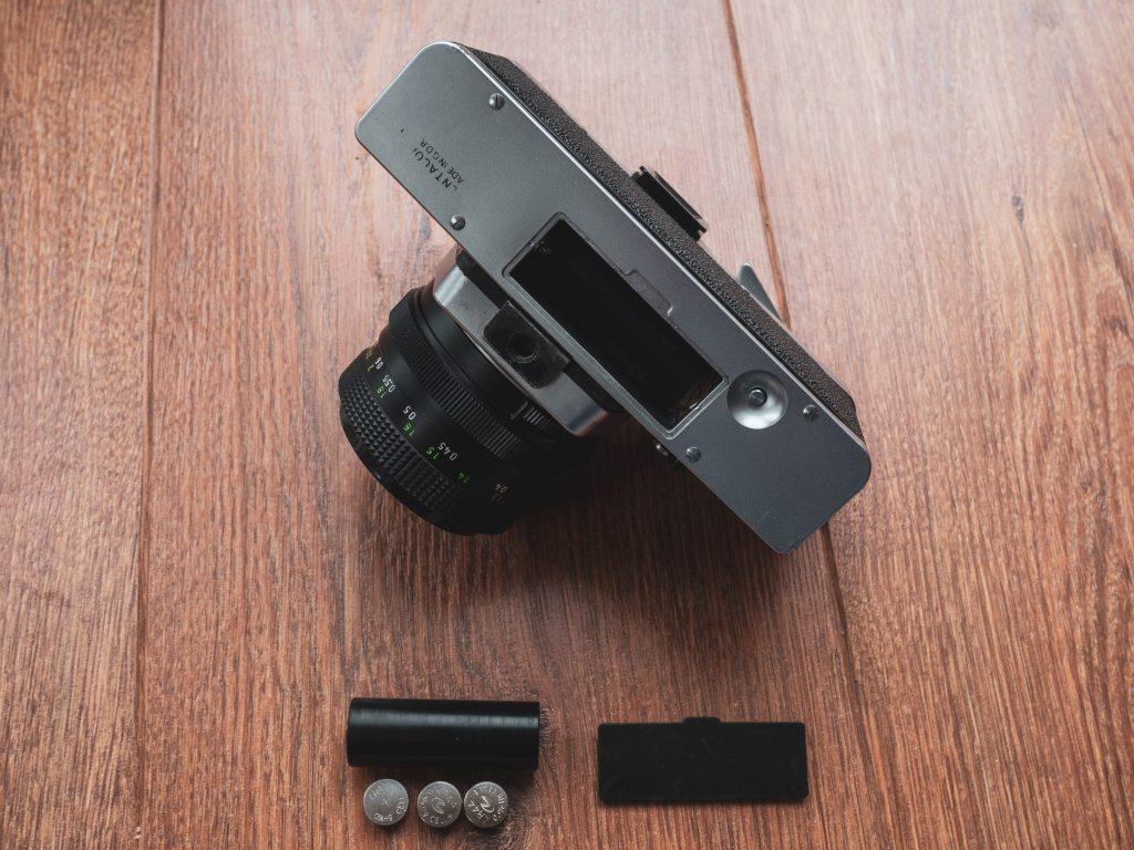 Praktica LLC with battery chamber adapter.